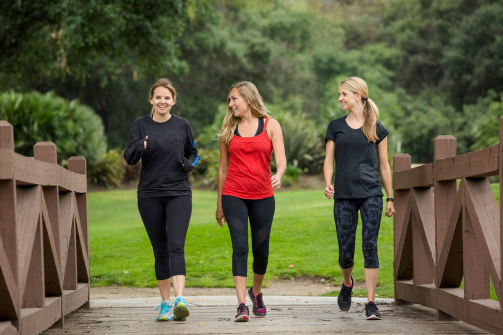 women-walking-together-in-the-outdoors